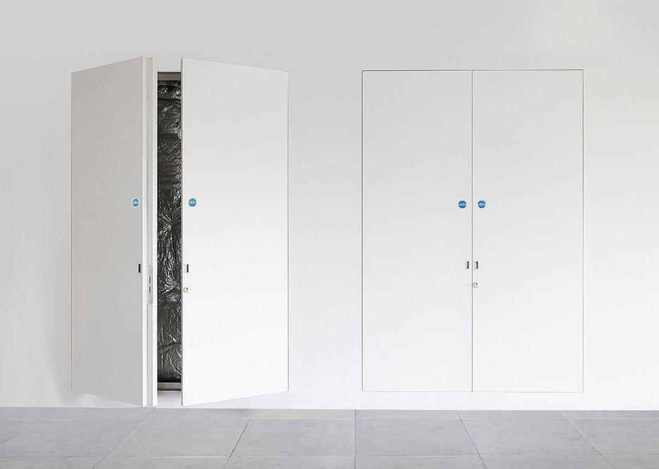 Hide unsightly apartment services using Quadra riser doors · Credit: Selo