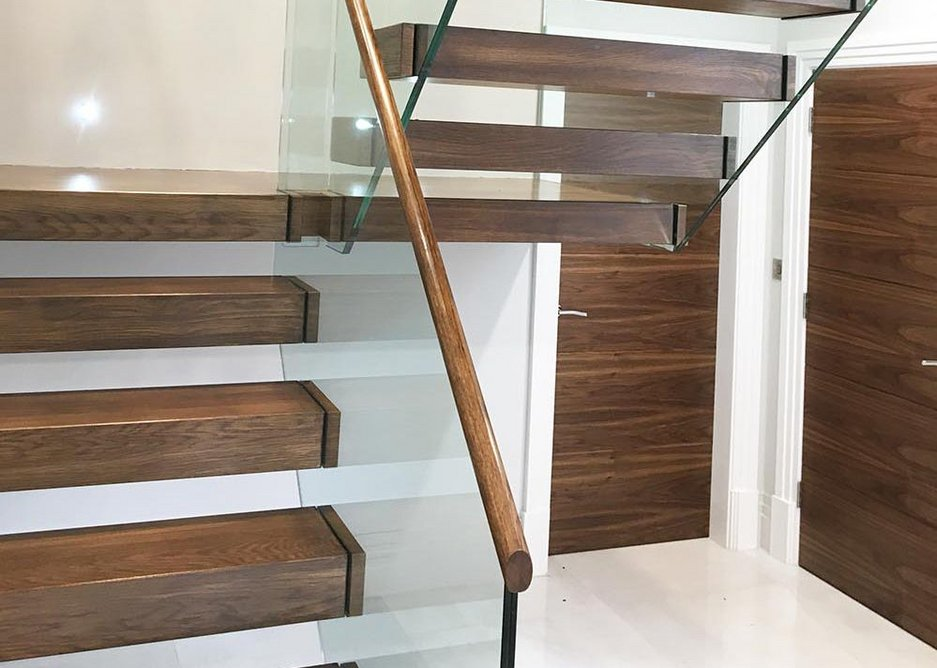Canal Engineering's latest cantilever staircase with walnut treads and a glass balustrade.