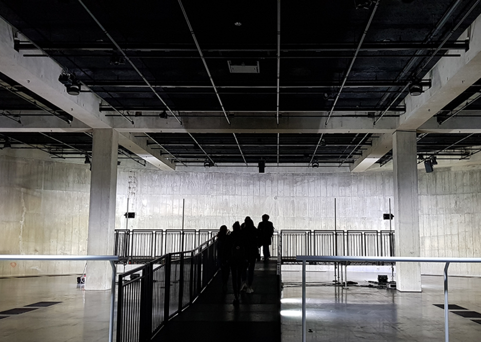 The oil tank industrial chambers at Tate Modern. SonaSpray K-13 in black was specified at 76mm. The black provides ideal conditions for lighting control and, in a darkened space, the height of the ceiling appears infinite.