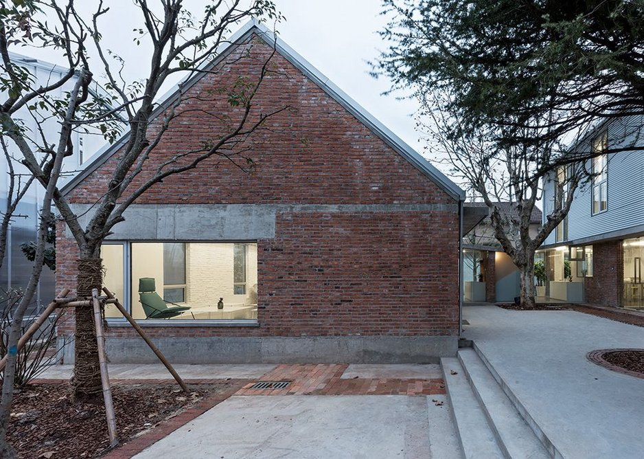 The tranquil courtyard at Atelier Deshaus' studio in the West Bund of Shanghai. The two-storey studio building is to the right and Yichun Liu's meeting room and own office to the left.