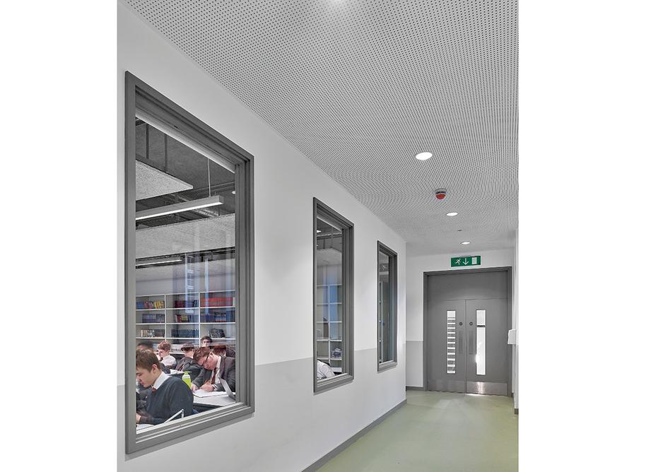 English department classrooms on the first floor borrow extra daylight via a corridor.