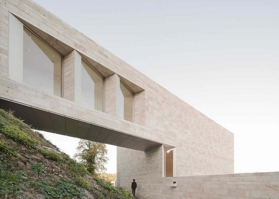 Travertine laid in courses of three different heights provides more subtle visual interest on the facade.