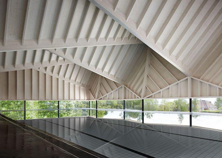Folded CLT roof above the water on Duggan Morris' Alfriston Pool in Buckinghamshire.