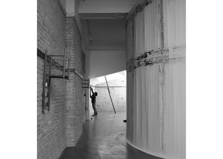 Carlos Bunga at work on the installation of his site-specific work Something Necessary and Useful at the Whitechapel Gallery.