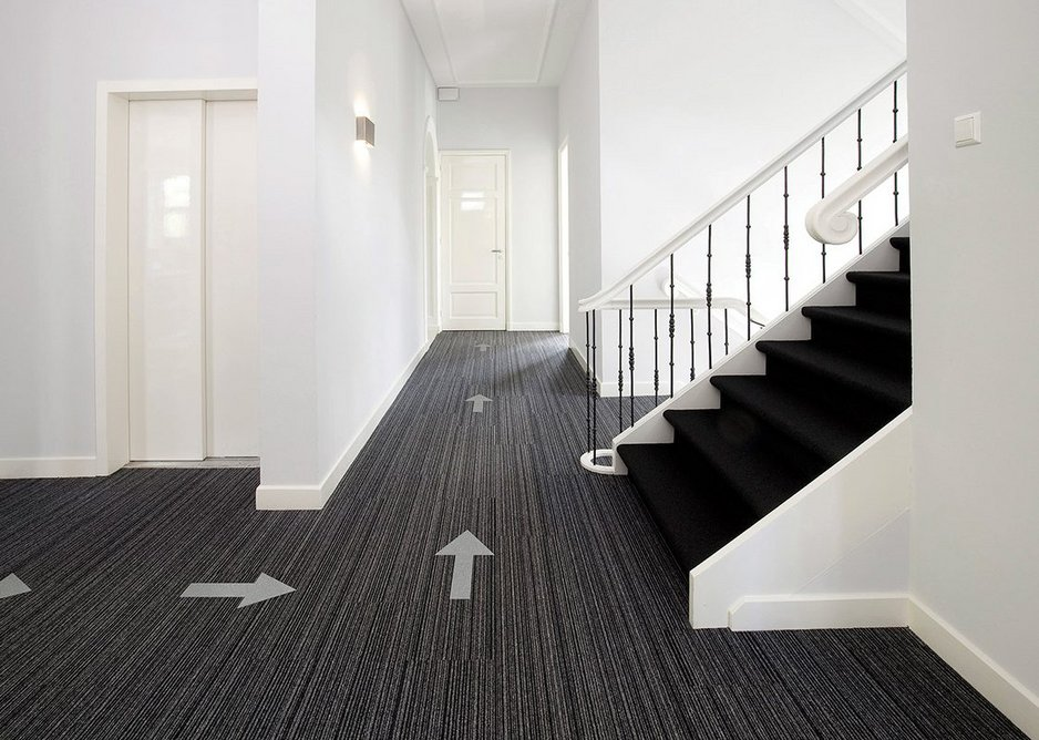 Tessera Outline carpet tiles with arrows: All 40 colours in the range can be used to produce directional tiles.