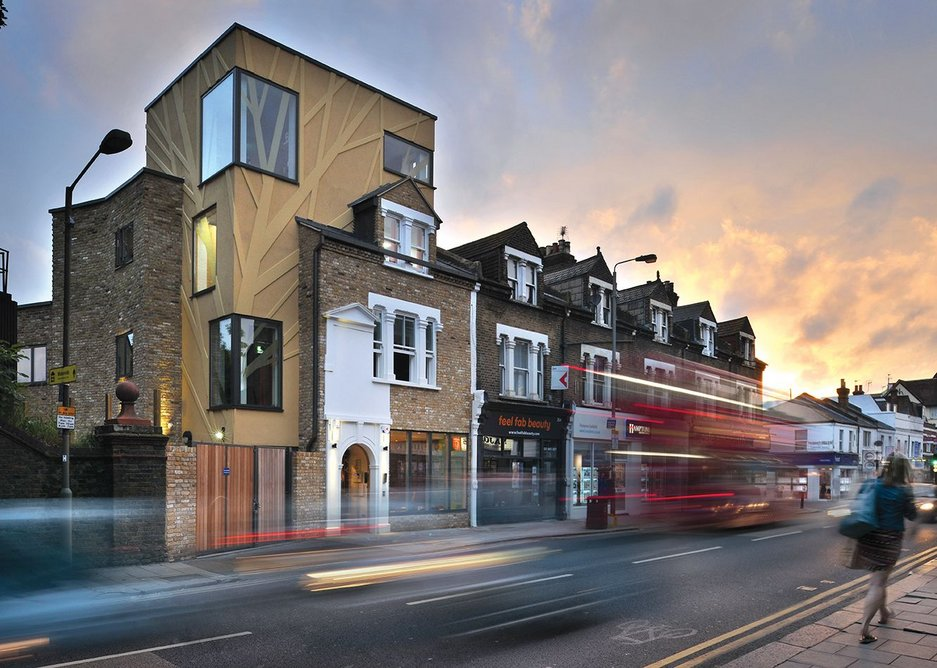 Aedas' Arts Team has inserted a mini rendered tower in the centre of the site, behind the Victorian shop fronts, to accommodate the extra office and rehearsal room.