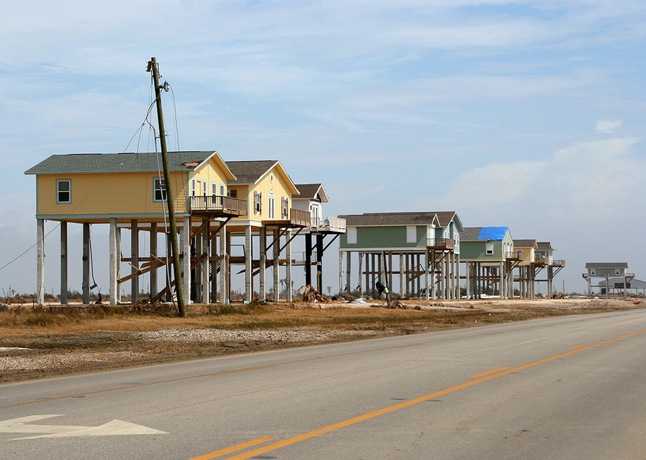 Elevated homes remain standing on the beach in the Bolivar Peninusla, Texas.