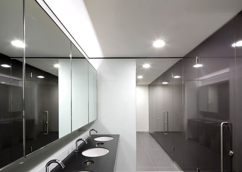 Art Deco themes in the lobbies are reflected in monochrome washroom finishes.