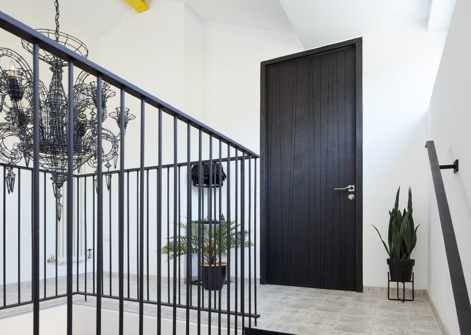 Urban Front Milano V internal doorset in Oak with ebony stain and Option 2 handle.