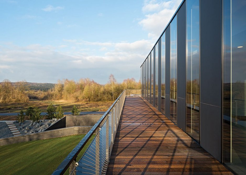 Four open terraces on the new top level give visitors 360-degree views across the forest toward the ossuary, scarred landscape and beyond