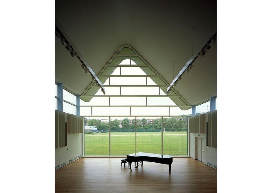 The recital hall window overlooking the playing fields is high performance to resist cricket balls and create acoustic separation.