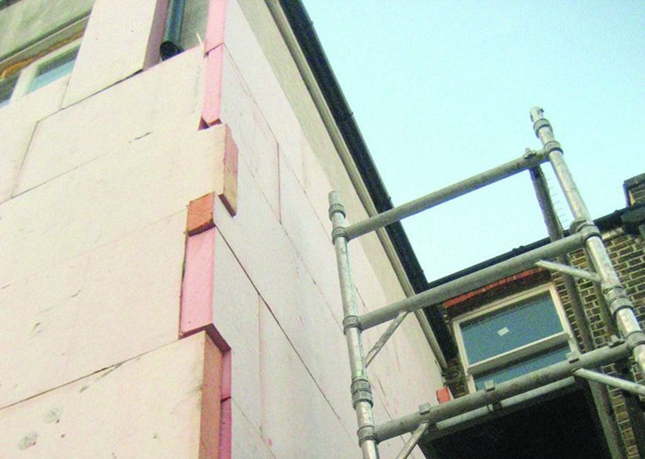 Rigid insulation is applied on batons directly to the exterior walls of the rear elevation.