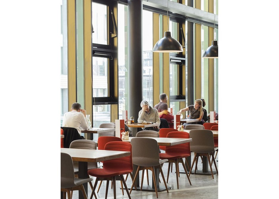 Concrete, crazed terrazzo and recycled iroko in the first floor restaurant.