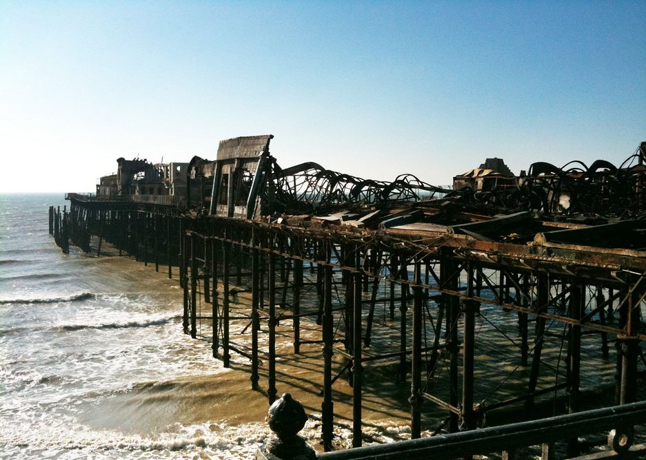Hastings Pier was devastated by fire in 2010. The Hastings Pier Charity formed in 2011 as a community benefit society to rescue it from falling further into the sea and find a new identity for pleasure piers.