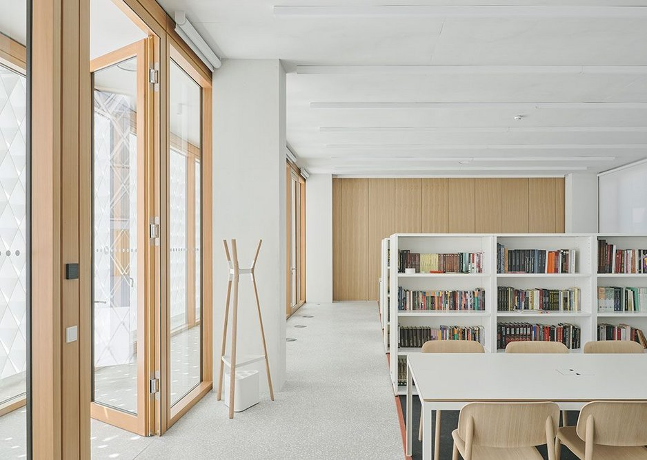 The new library, again a tranquil white and wood space.