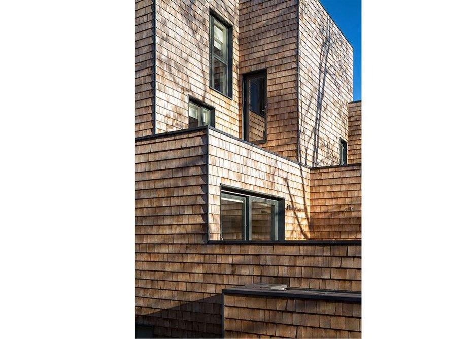 Cedar shingles cover facing elevations…