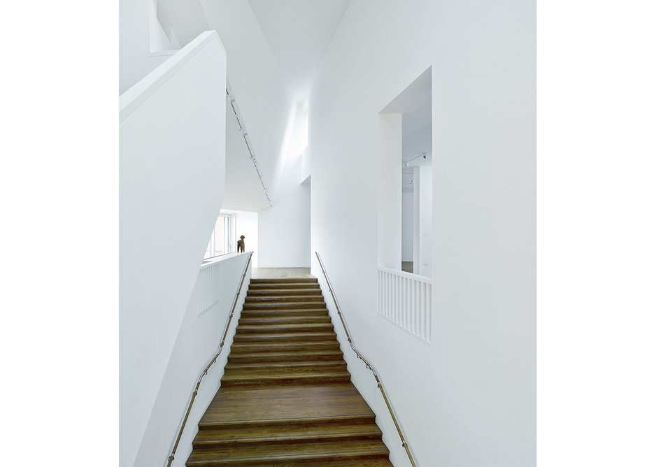 The main staircase leads down to the communal family areas from the recital and gallery level.