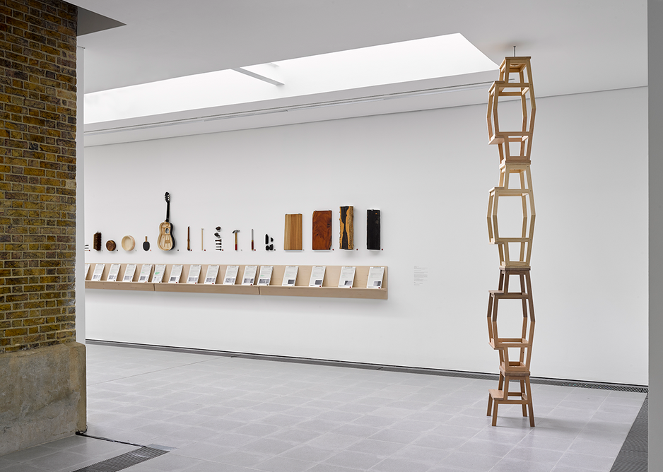 Installation view of Formafantasma: Cambio at the Serpentine Galleries, London. Photo credit: George Darrell. To the right is a stack of stools made from wood of varying longevity.