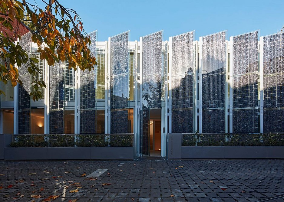 The full height, double-glazed elevation can be seen behind the angled solar shutters. Photo: Dennis Gilbert. Courtesy HCL Architects.