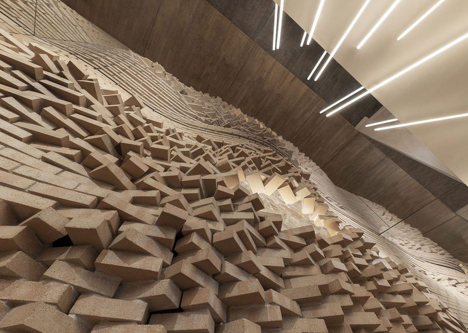 A total of 1085 compressed raw earth bricks make up the wall.