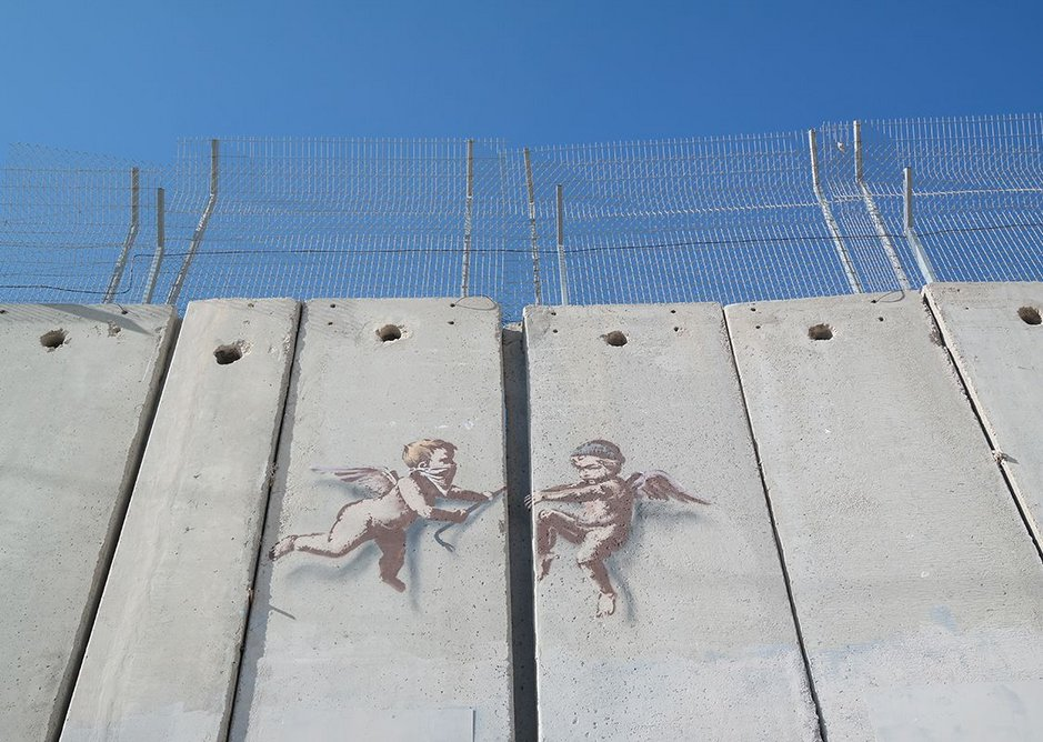One of Banksy's celebrated stencils makes its point.