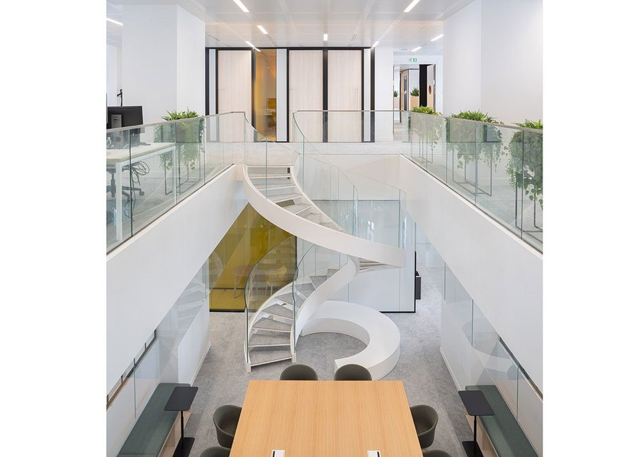 Spiral staircases connect consecutive office levels.