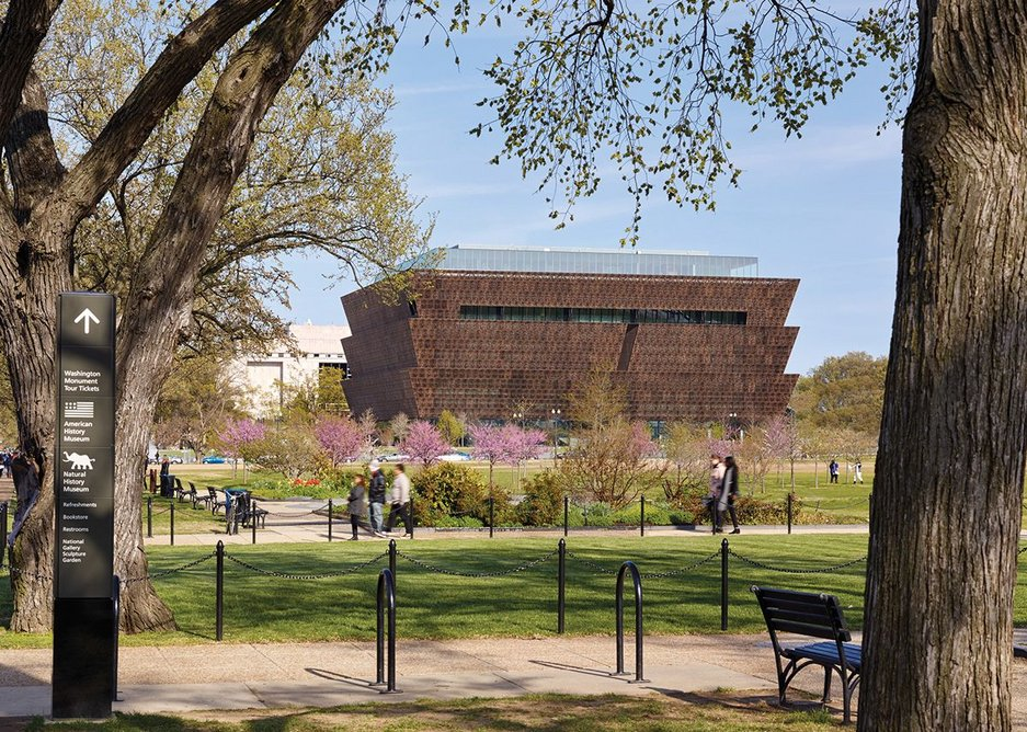 The inverted ziggurat of the NMAAHC from the National Mall Memorial Park, looking east.
