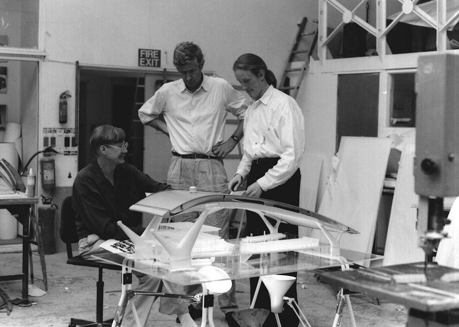 Nicholas Grimshaw (left) discussing the Airport of the Future exhibit for the 1991 Venice Biennale with Jan Kaplicky (centre) and Simon Templeton (right).
