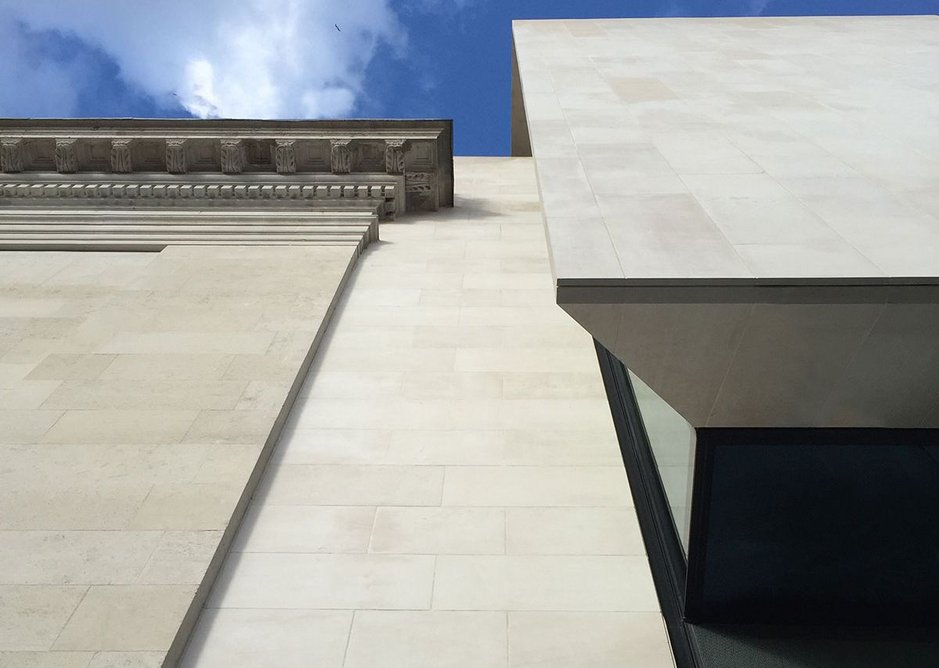 A smooth strip of limestone acts as a simple canvas for the 1914 Council House and the new wall.