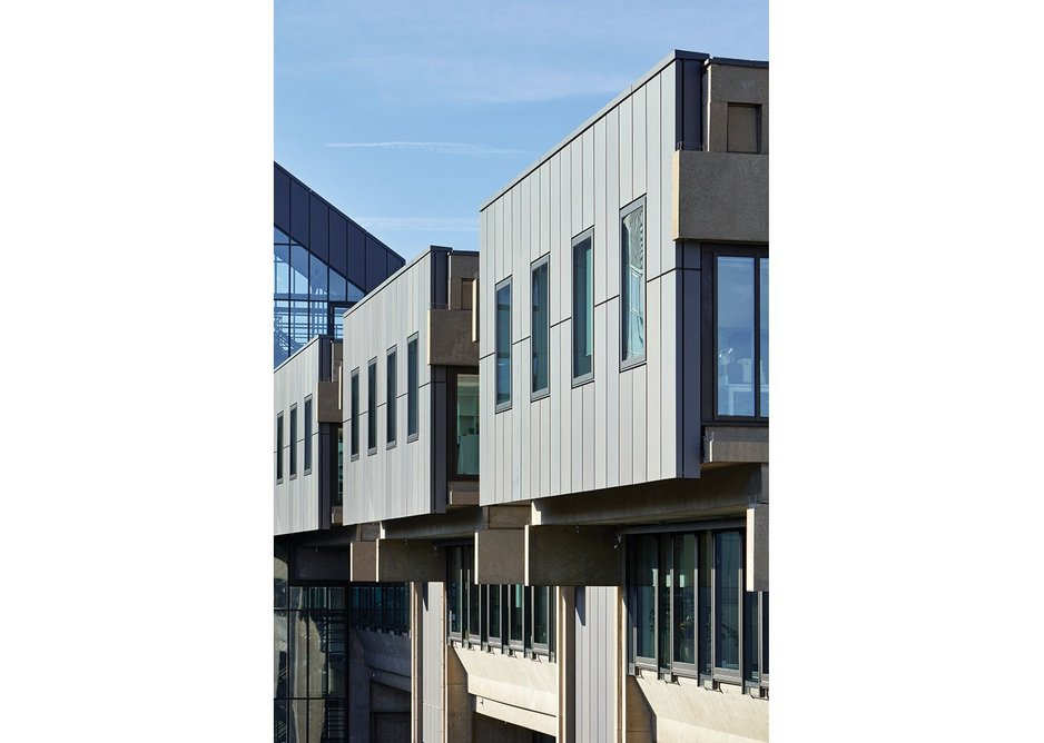 On the east and west facades, new top-hung windows are inserted into reclad bays.