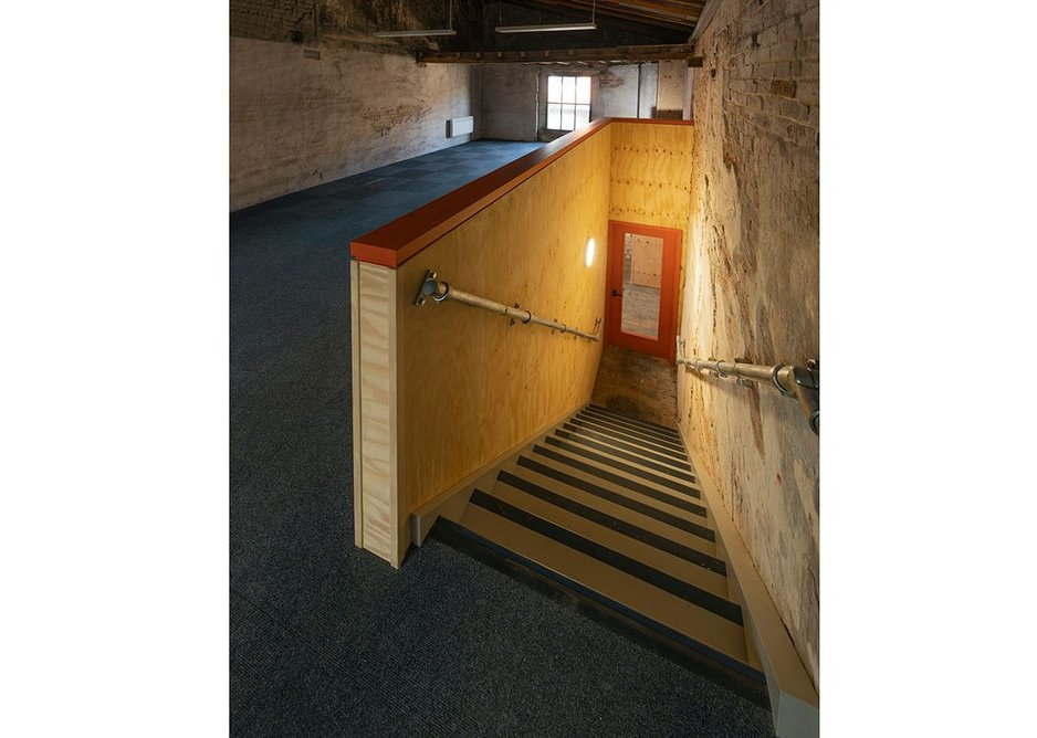 A training room is one of the new community spaces in the former Treadgold ironmongery building. New interventions are clearly expressed.