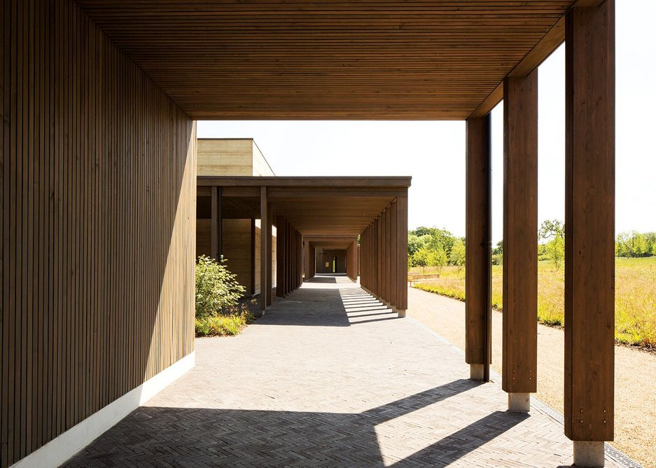 A covered walkway built from larch glulam provides a processional route for the burial.