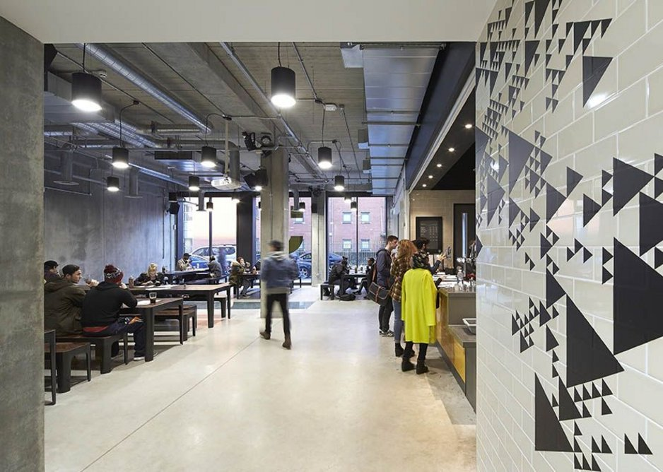The graphics, including these stick on geometries in the bar, are skilfully designed by Holden and Sons.