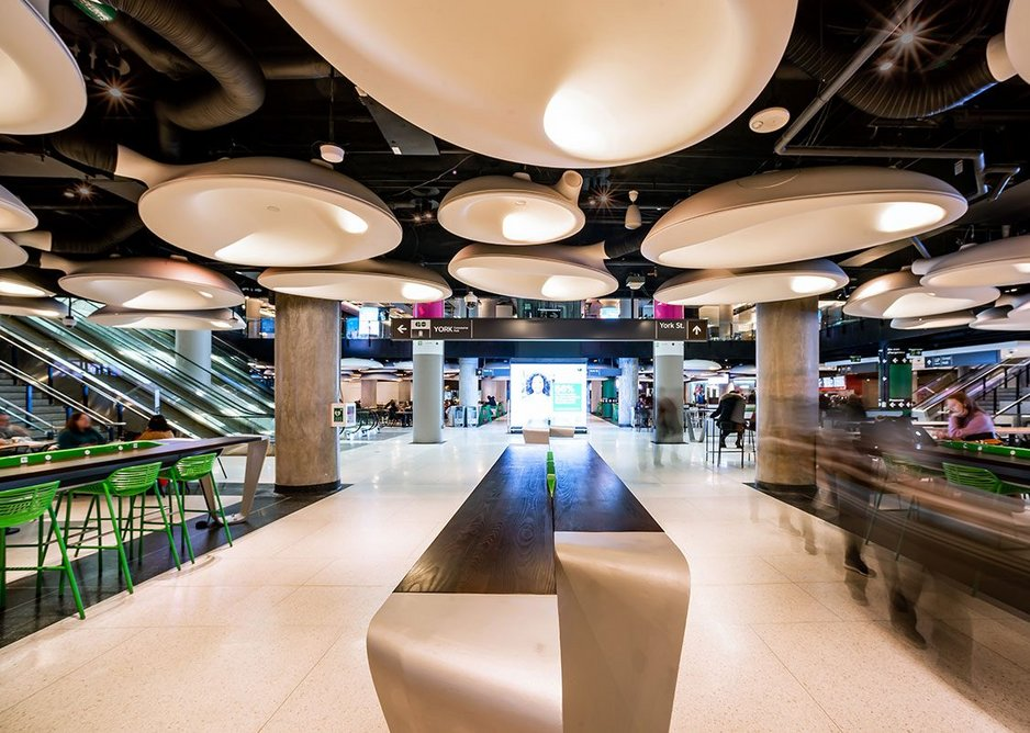 Ear-like blobs integrate air conditioning, light, loudspeakers and acoustic insulation in the food court at Union Station.