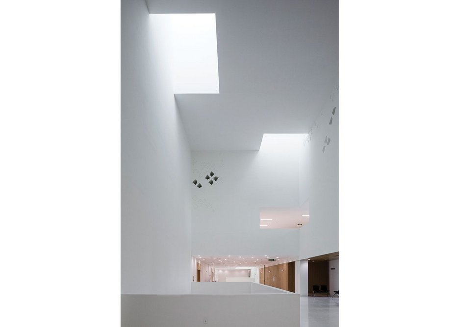 High level light funnels control the harsh Andalusian sunlight to let it filter into the central spine.