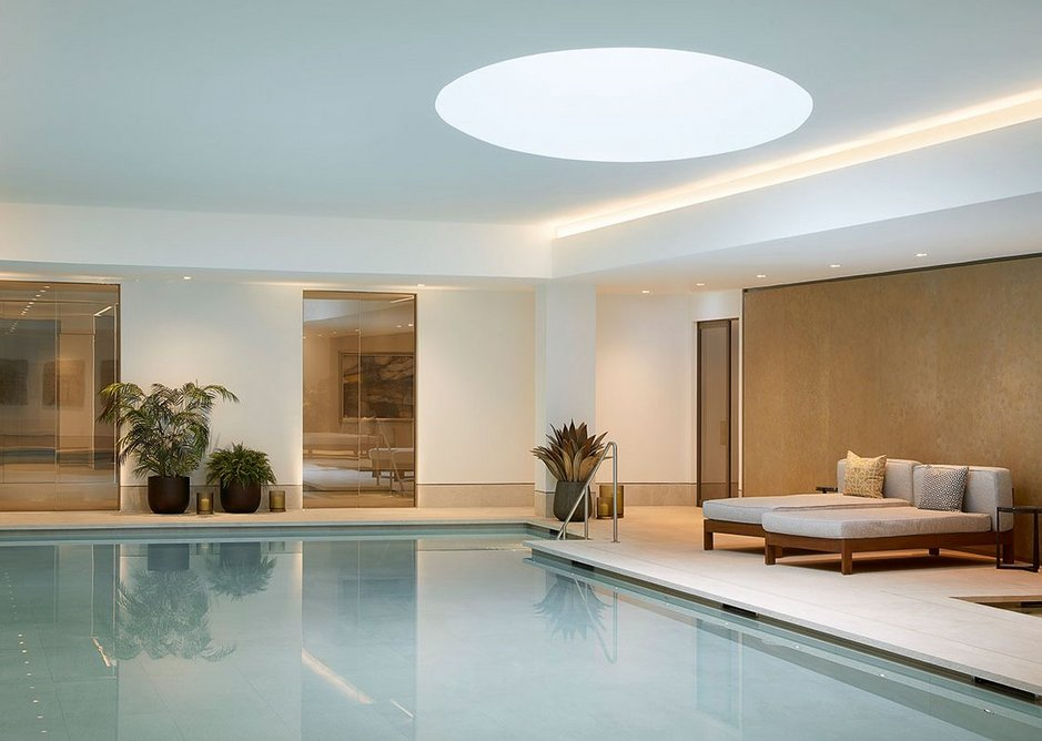 The swimming pool, one of many communal amenities in the basement. Porcelain floor and wall tiling by Domus supply the required durability with the appearance of limestone.