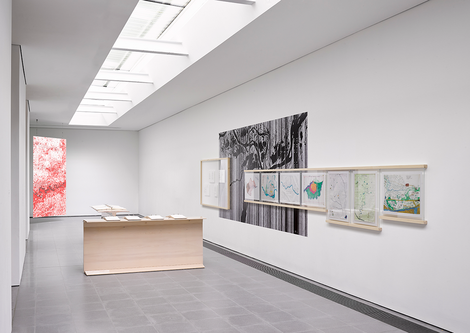 Installation view of Formafantasma: Cambio at the Serpentine Galleries, London. Photo credit: George Darrell. To the right are maps of the Amazon drawn up by indigenous communities.