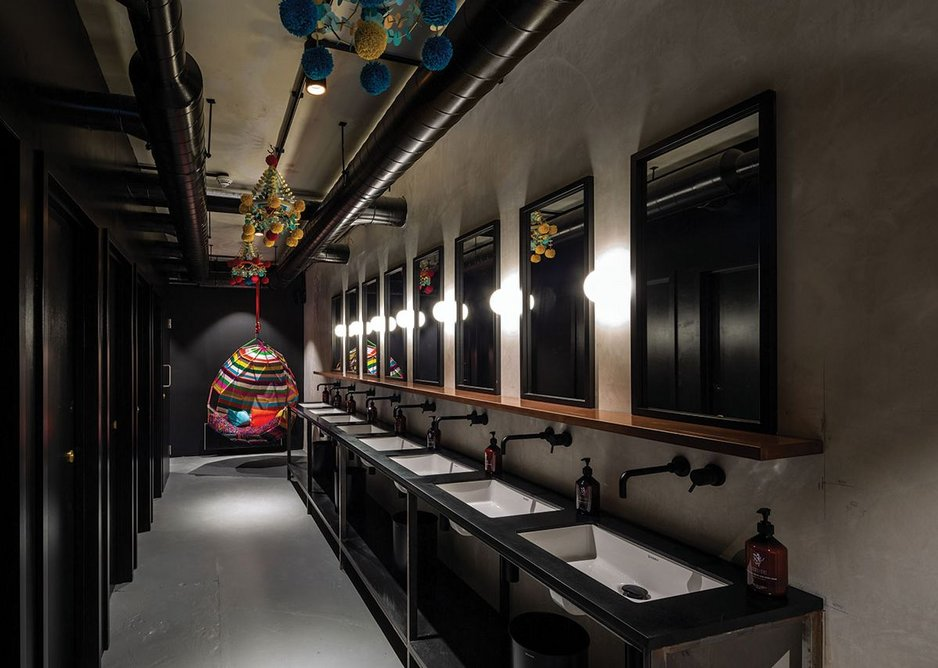 Lavatories reference 'nightclub' more than 'workspace'.