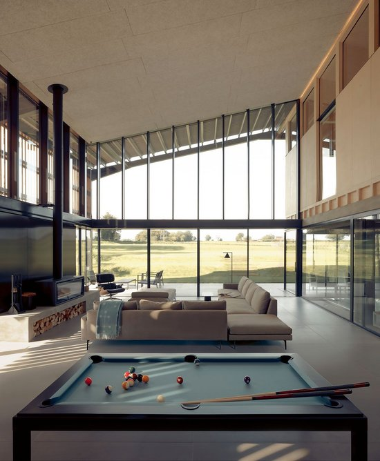 View from the kitchen island over the pool table and living room to the big skies.