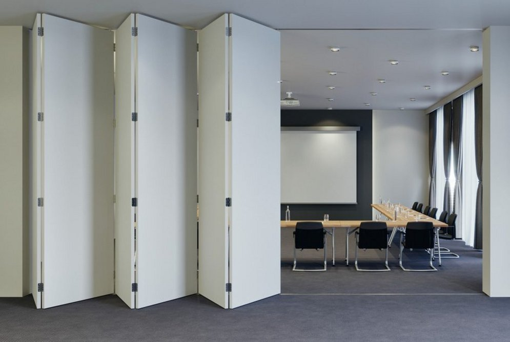 Slido 100T (Slido Fold 32) folding sliding door system: Flexible, transformable office spaces in an instant.