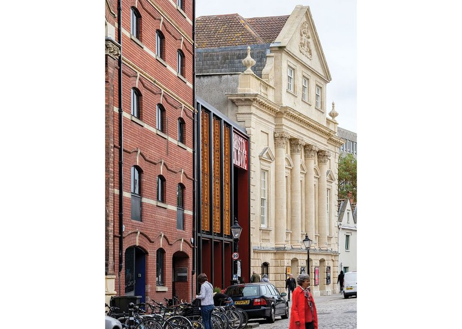 The slim lines of Haworth Tompkins' new facade alongside the historic Cooper's Hall on Bristol's King Street.