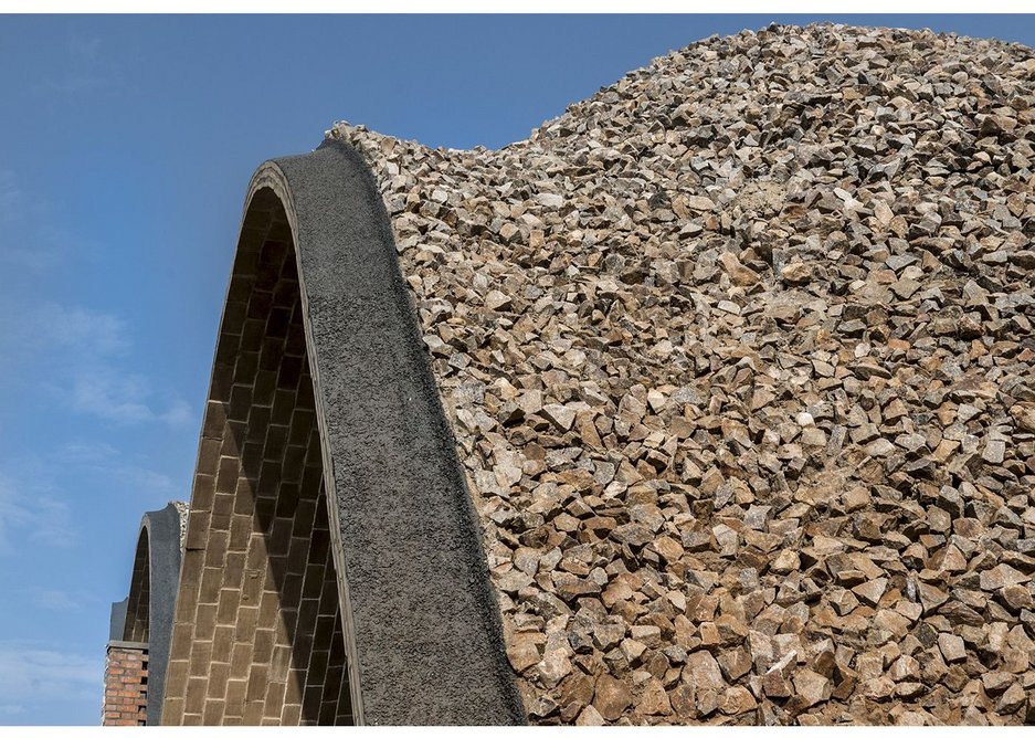 The cricket pavilion vaults are covered with small granite rocks set into mortar.