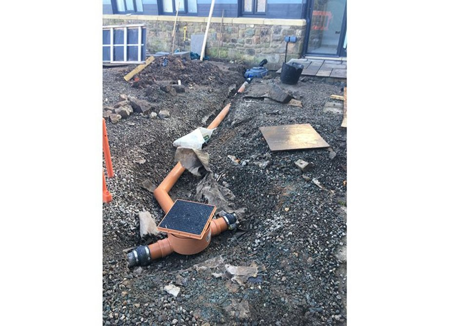 The drain is connected to a septic tank, which is located further along the garden and served by drain pipes with sufficient gravity fall.