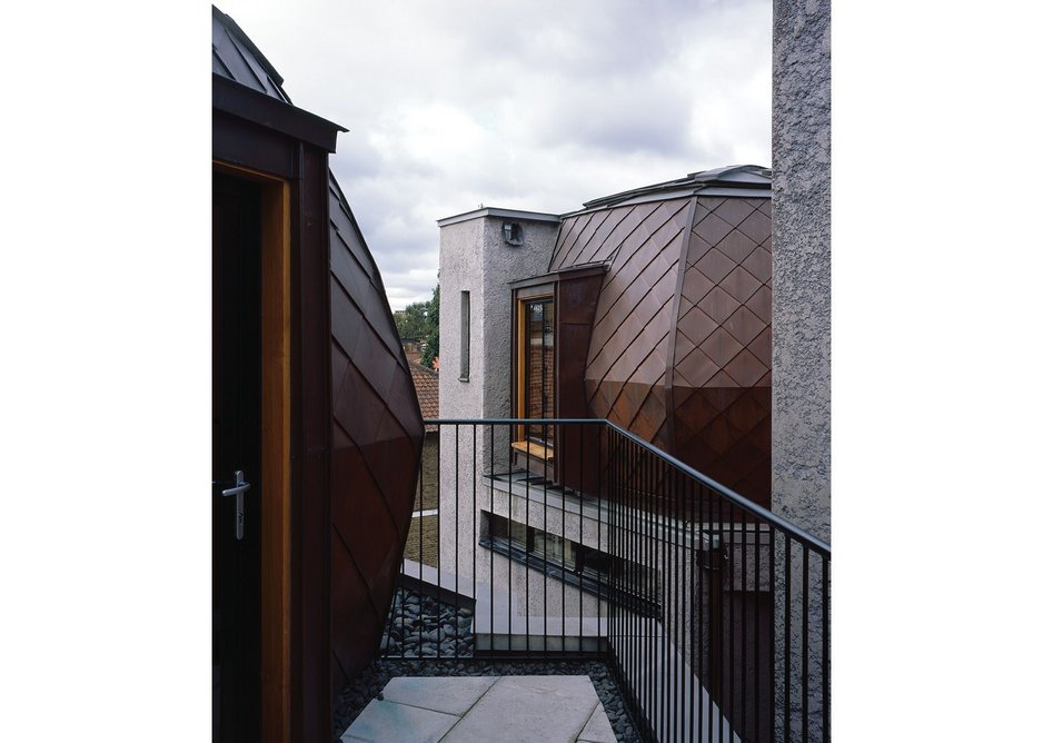 Houses A, B & C are crowned with copper-clad timber yurts, creating a strange bespoke roofscape.
