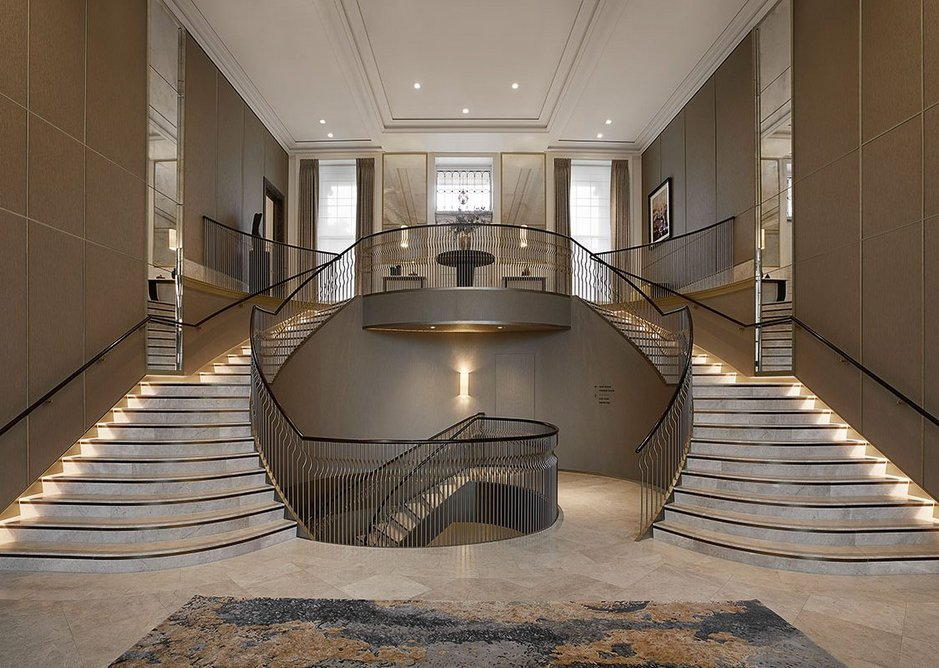 A double staircase sweeps down from the main entrance on the crescent to the reception. Interiors are by Millier London, which combined pale limestone flooring from Tasca Stones with contrasting dark metal detailing.