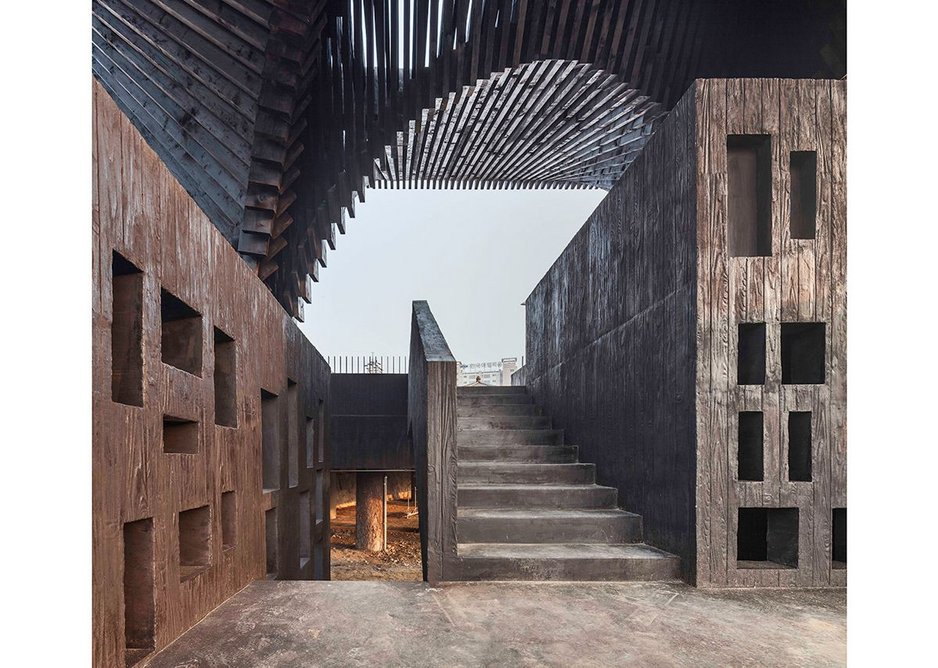The Gwangju River Reading Room, designed by Adjaye Associates in South Korea collaboration with writer Taiye Selasi, includes niches for books about social justice and protest.