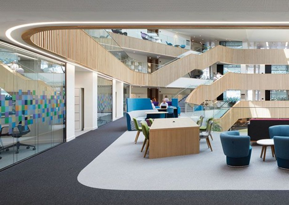 Terraces of flexible space follow the diminishing floor plates down in the central atrium.