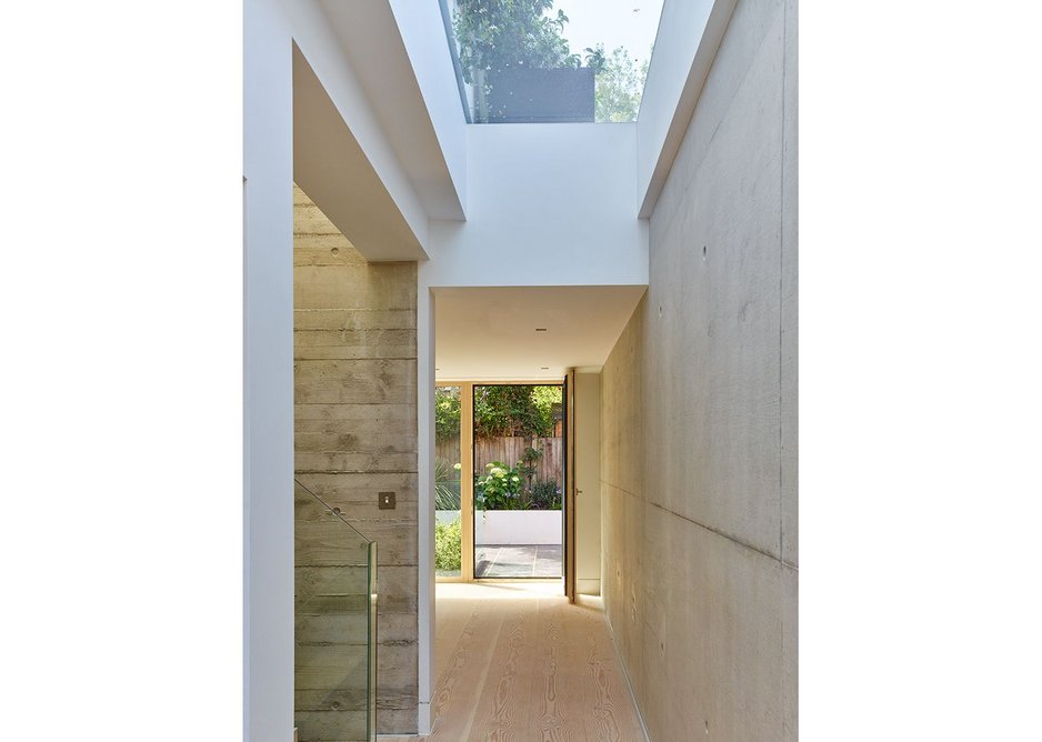 Interior of a new Richard Dudzicki Architects-designed home in west London with large rooflights.
