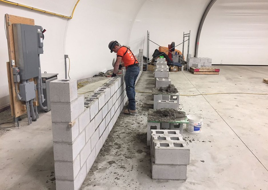 With bricklaying evolved lifting strategies over time seem to prove more effective than taught approaches.