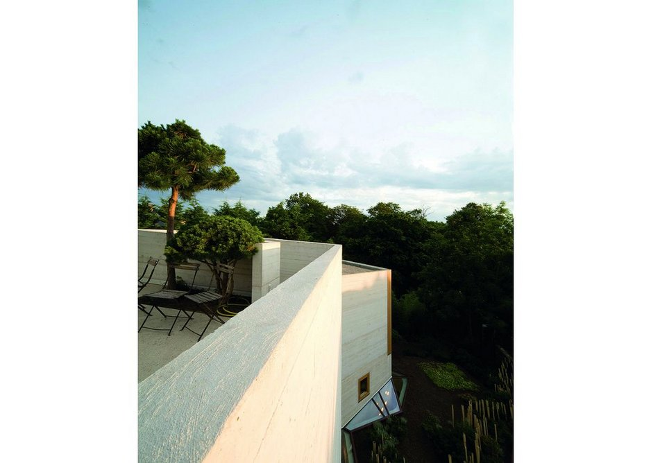 The roof terrace of the parents' bedroom gives views over the trees to La Défense in Paris.